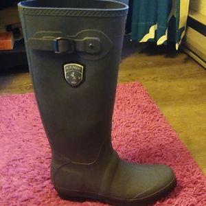 Knee high rain boots